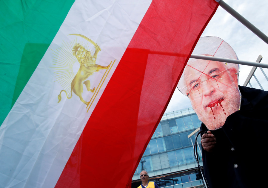 People demonstrate against the official visit of Iranian President Hassan Rouhani in Bern, Switzerla