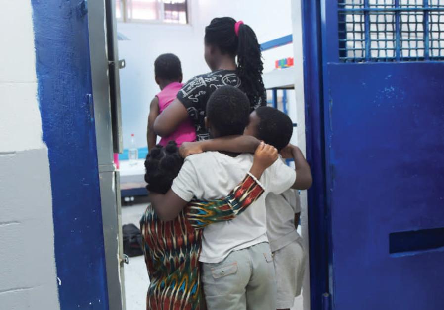 A Nigerian woman and her children in Givon prison