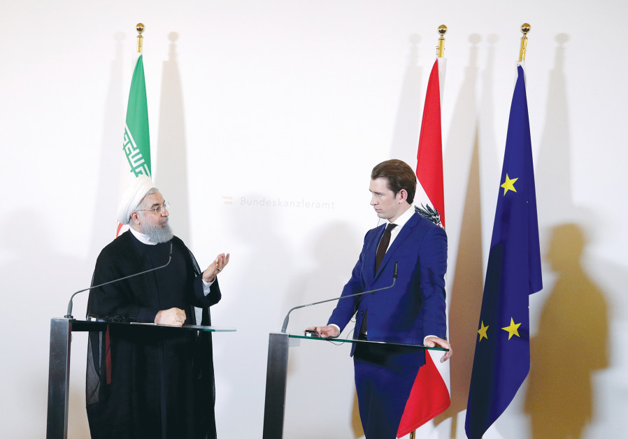 IRAN PRESIDENT Hassan Rouhani and Austrian Chancellor Sebastian Kurz attend a news conference at the