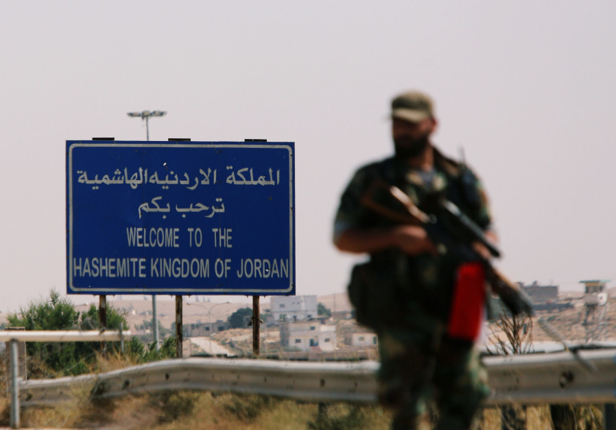 A Syrian soldier is seen standing in the Nasib border crossing with Jordan in Deraa, Syria July 7, 2