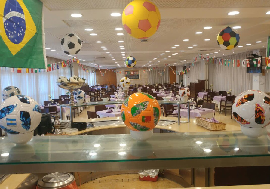 Soccer balls and world flags hung up around the Knesset cafeteria, July 8, 2018