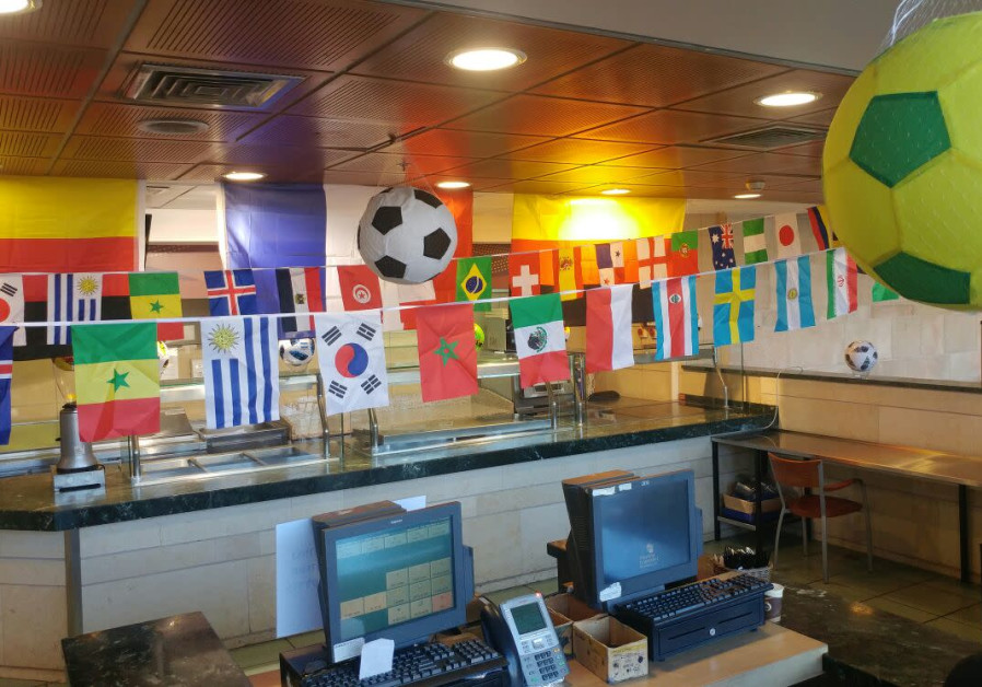 Soccer balls and world flags hung up around the Knesset cafeteria, July 8, 2018 (Knesset)