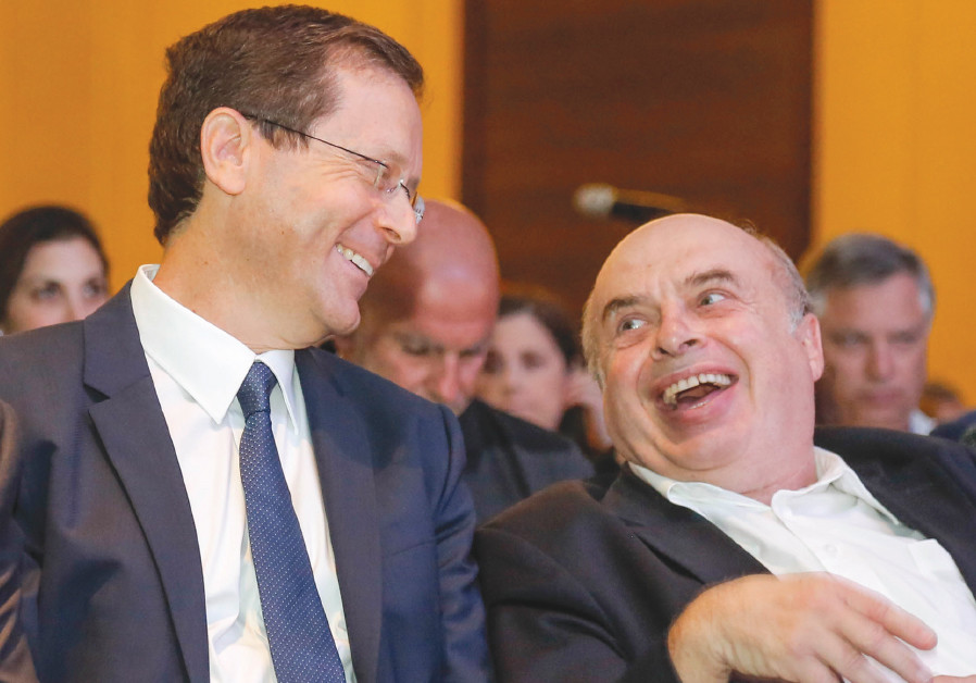 Isaac Herzog shares a laugh with Natan Sharansky following Herzog's election as chairman of the Jewi