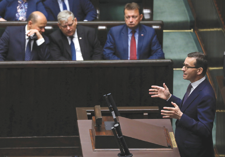 Poland's Prime Minister Mateusz Morawiecki speaks during the debate about the Holocaust legislation