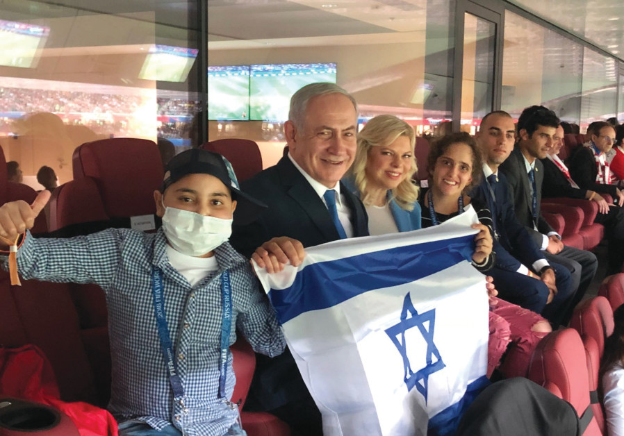 Prime Minister Benjamin Netanyahu and his wife, Sara, proudly display Israel's flag at the World Cup