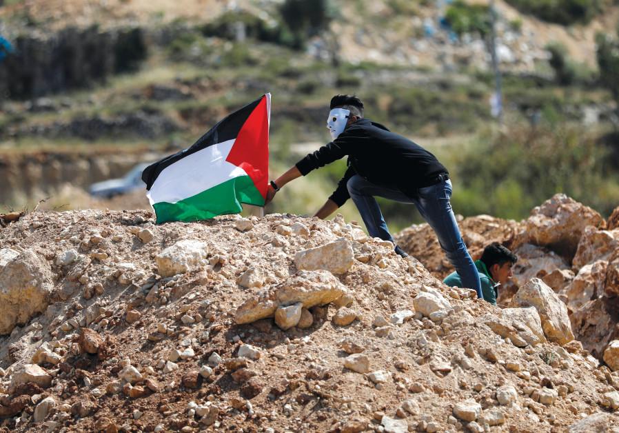 A Palestinian demonstrator protesting on 'Nakba Day'
