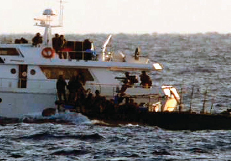 SOLDIERS BOARD one of the two Gaza-bound boats carrying pro-Palestinian activists in the Mediterrane
