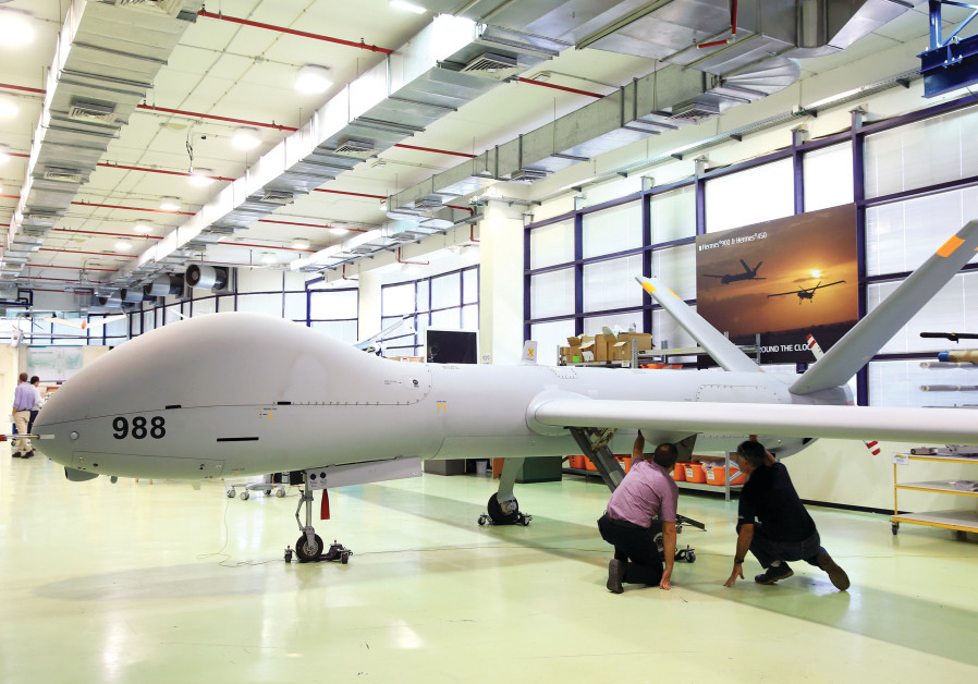 EMPLOYEES CHECK an Elbit Systems Ltd. Hermes 900 unmanned aerial vehicle (UAV) at the company's dron