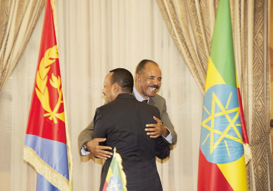 ETHIOPIA'S PRIME Minister Abiy Ahmed and Eritrean President Isaias Afwerk embrace at the declaration