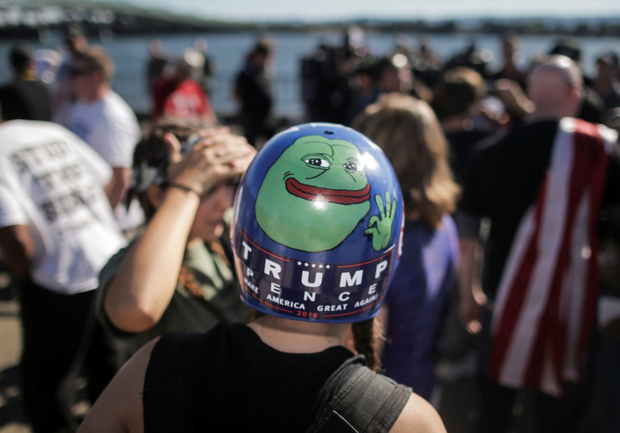 Jaeda Ferrel wears helmet with an image of Pepe the frog and a Trump/Pence sticker at a rally