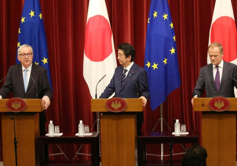 Juncker, left, Abe, center and Tusk, right
