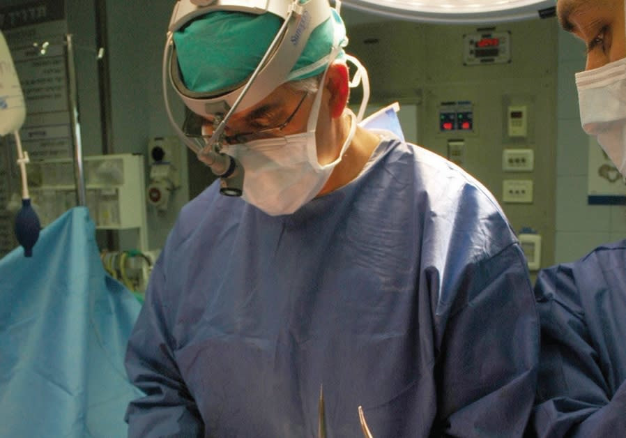 PROF. AVIRAM NISSAN performing lifesaving surgery at Sheba Medical Center.