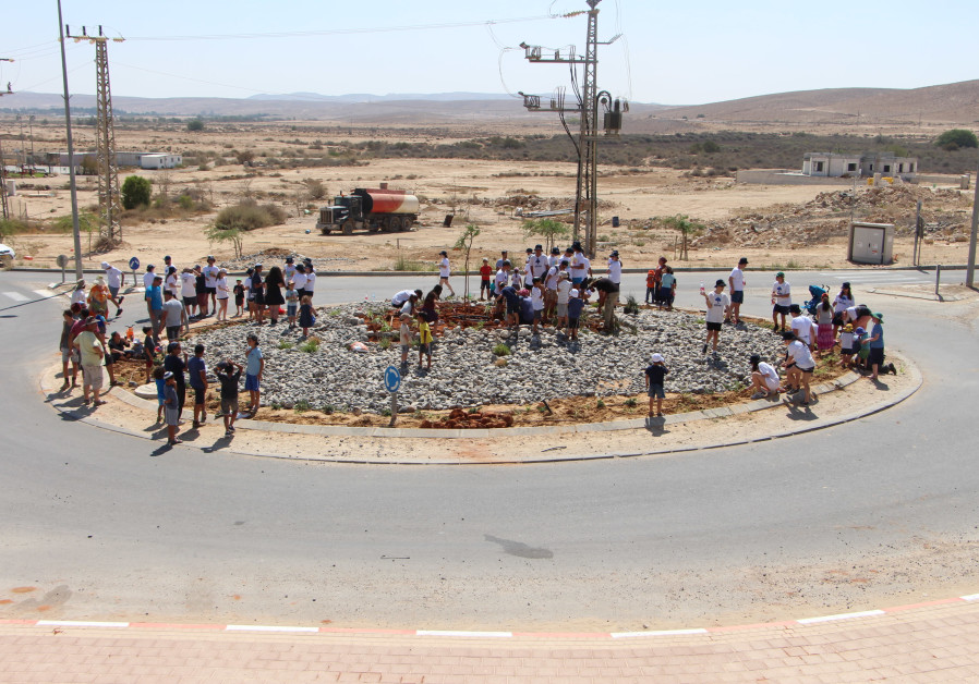 Youth from Perth and Merhav Am plant trees together on the new Merhav Am roundabout