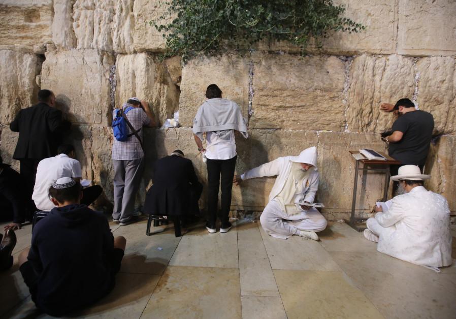 Men pray at the Western Wall, Tisha B'av, 2018