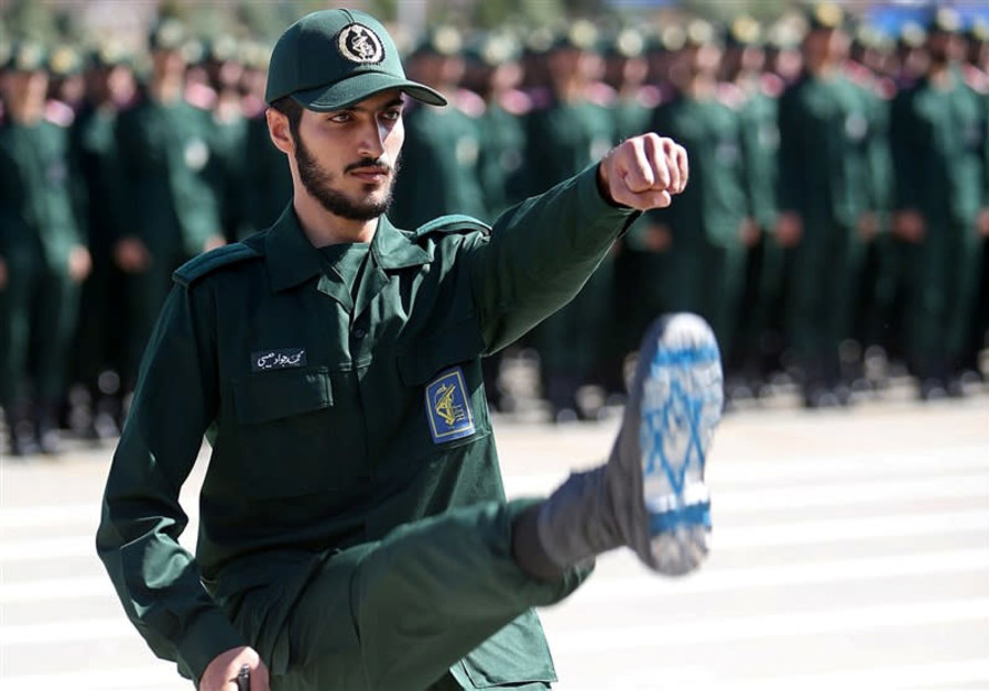 An Iranian Officer of Revolutionary Guards with Israel flag drawn on his boots