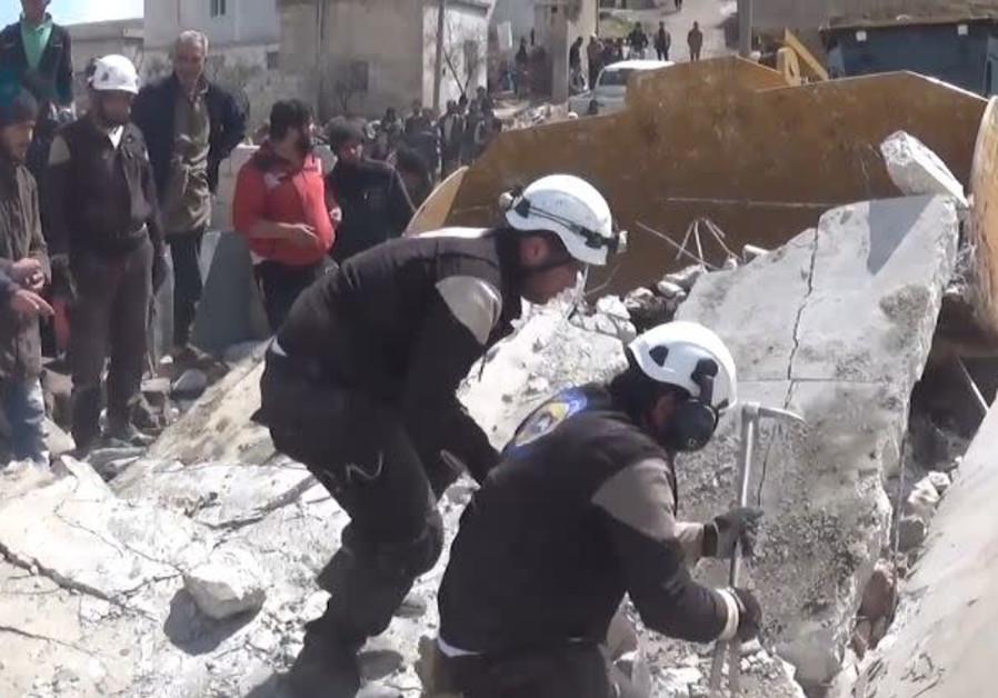 White Helmets of the Syrian Civil Defense in Kafrowaid, a village near Idlib in Syria