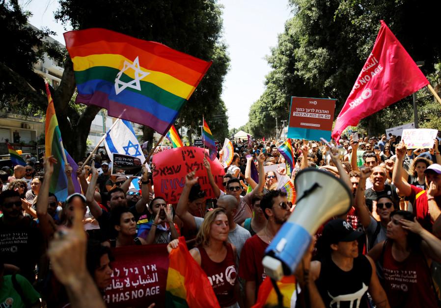 Protestors shout slogans during a LGBT community members protest against discriminatory surrogate