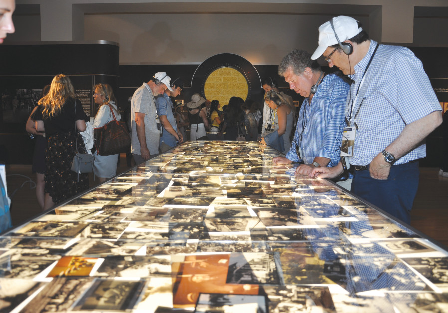 PARTICIPANTS IN the Generation to Generation Mission tour the Flashes of Memory exhibition