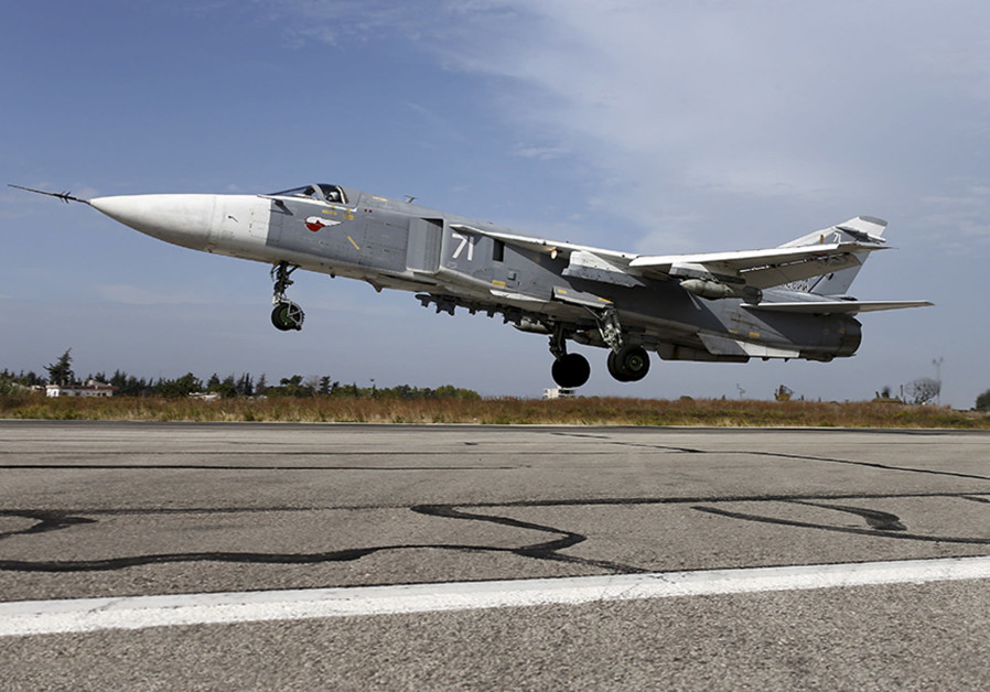 A Sukhoi Su-24 fighter jet takes off from the Hmeymim air base near Latakia, Syria, in this handout