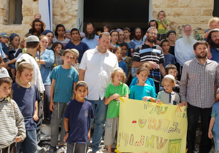Settlers hold a protest at Sa-Nur, demanding its reconstruction