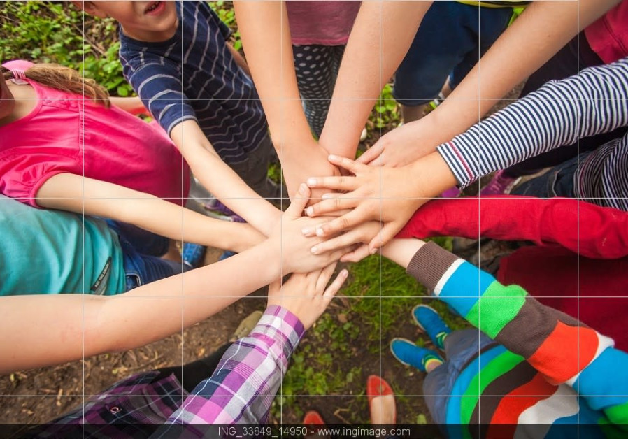 Children join hands in nature [illustrative], summer camp, unity