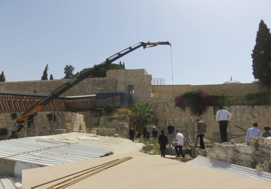 A crane clears a fallen stone from the Western Wall, July 25 2018