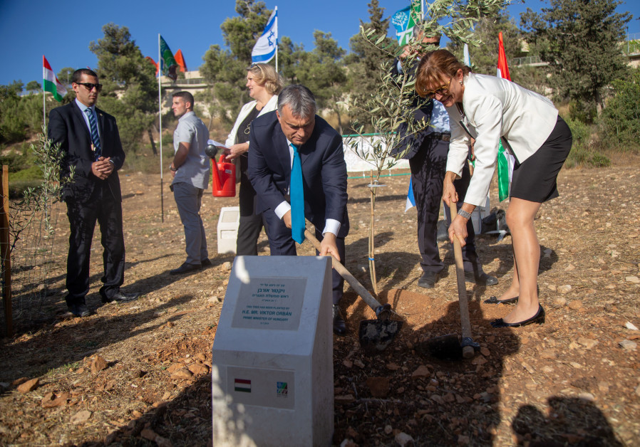 Hungarian PM Viktor Orbán plants an olive tree in the Grove of Nations, together with his wife Anikó