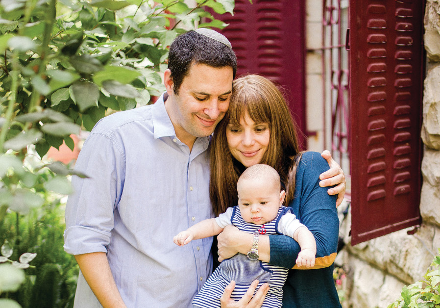 Sarah Novick pictured with her husband, Ariel, and their son in Jerusalem (Tzipora Lifchitz Photography)