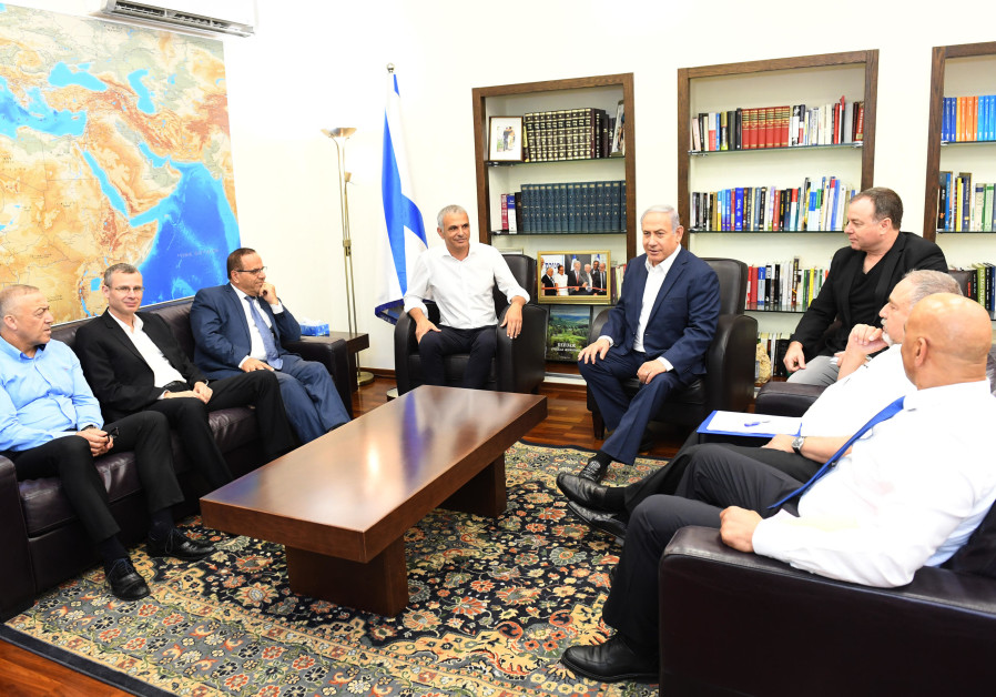 Prime Minister Benjamin Netanyahu and others discussing the needs of the Druze community