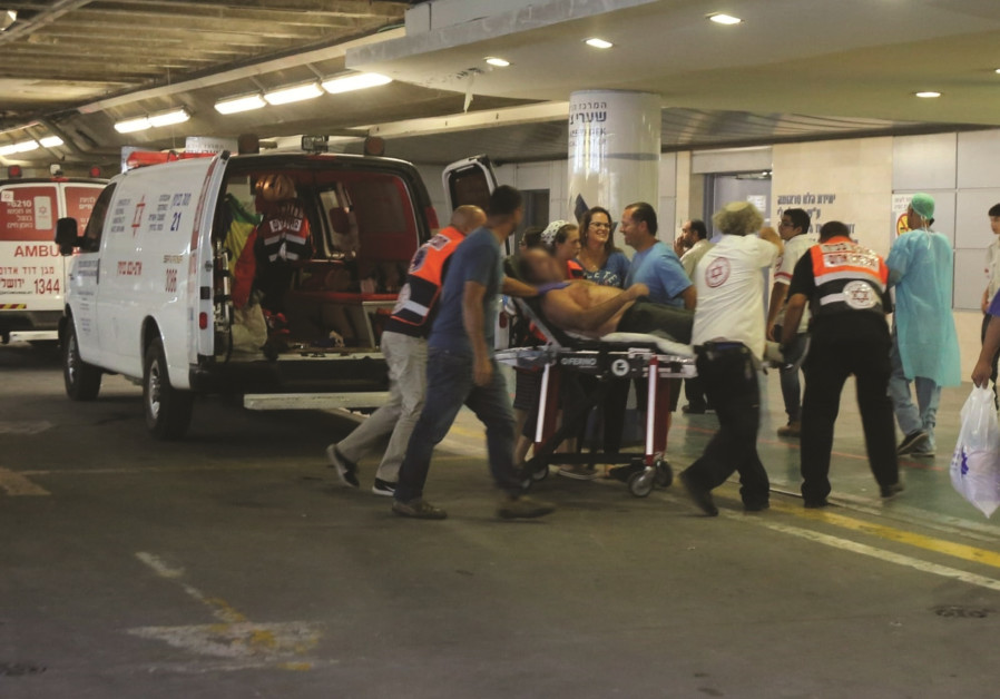 One of the victims of the stabbing attack are evacuated to Shaare Zedek Medical Center, July 26, 201