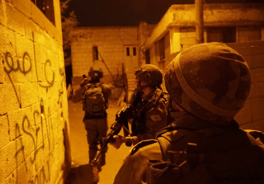 IDF soldiers seen during overnight activity following Thursday's stabbing attack