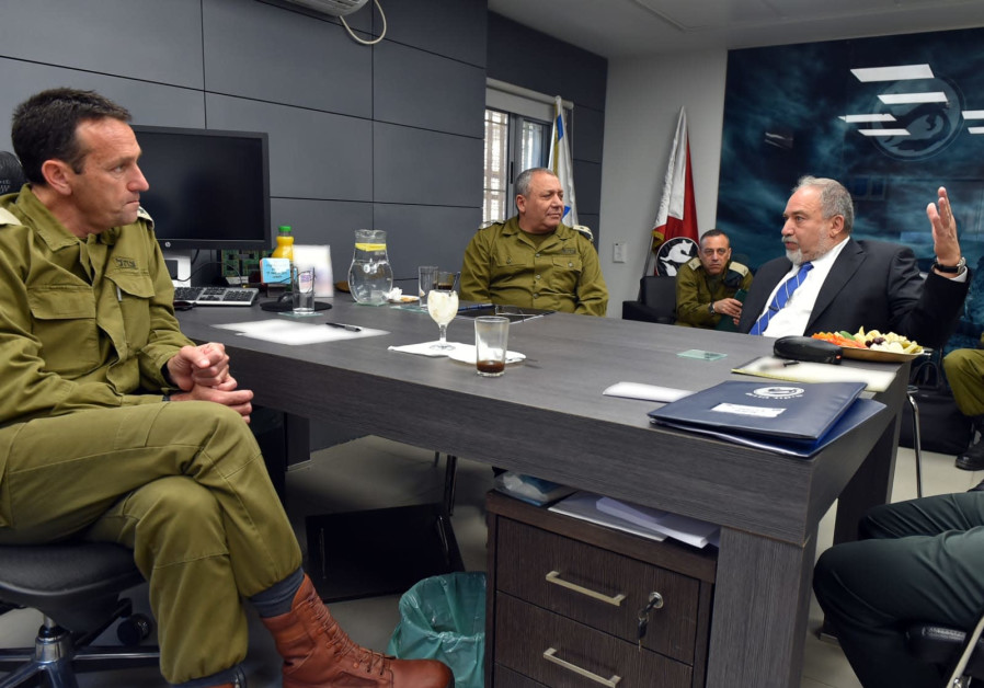 Defense Minister Avigdor Liberman (R) is briefed about the security situation near Gaza