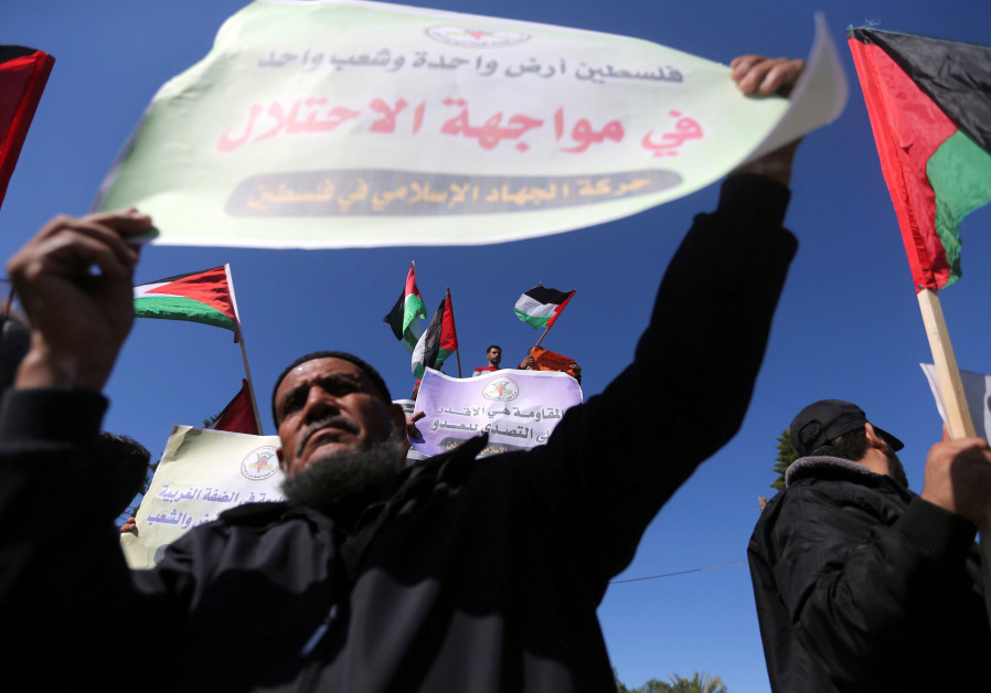 Palestinians take part in a protest calling on Hamas and Fatah factions to conclude the reconciliati