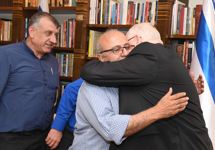 President Reuven Rivlin hugs heads of Druze local Councils at the President's Residence on Sunday, J