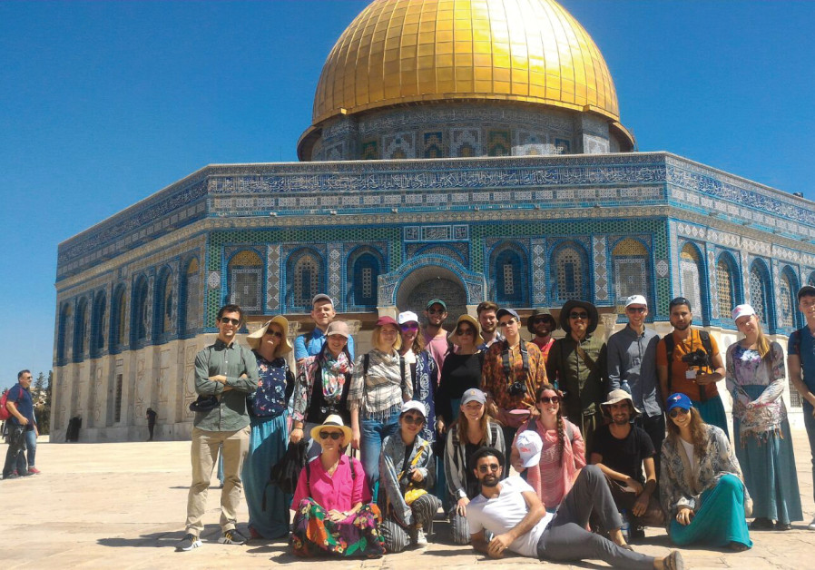 The participants of the 2018 Jerusalem Film Workshop, with the Dome of the Rock in the background
