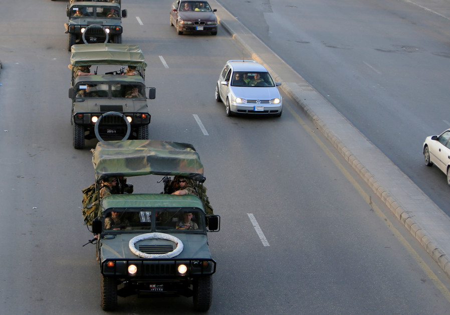 Lebanese army soldiers patrol the city on the eve of the country's parliamentary election, in Sidon