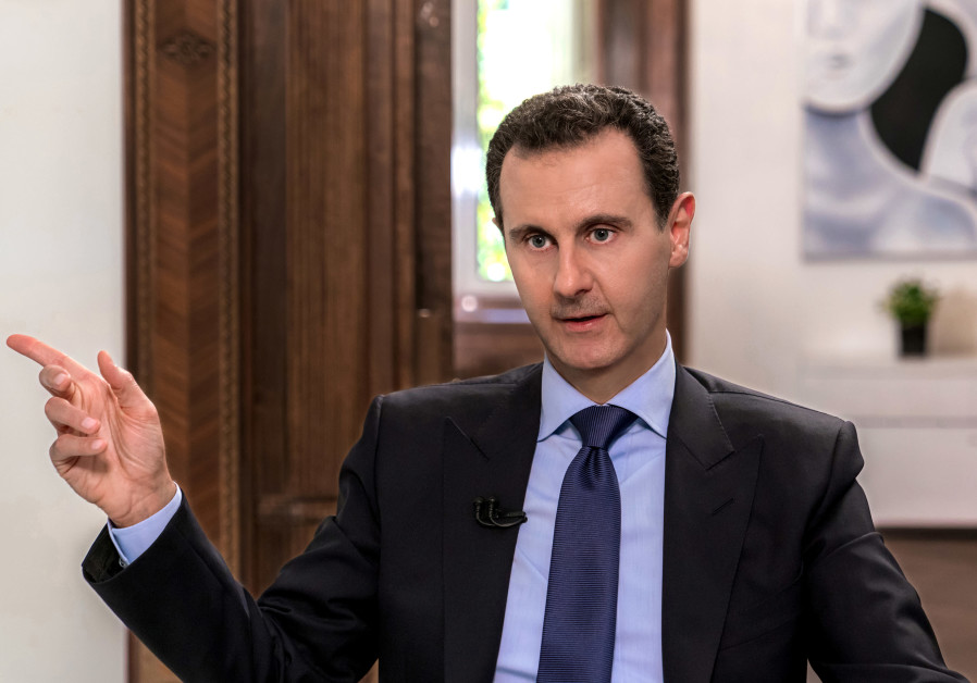 Syrian President Bashar Assad speaks during an interview with Russian television channel NTV, in Dam