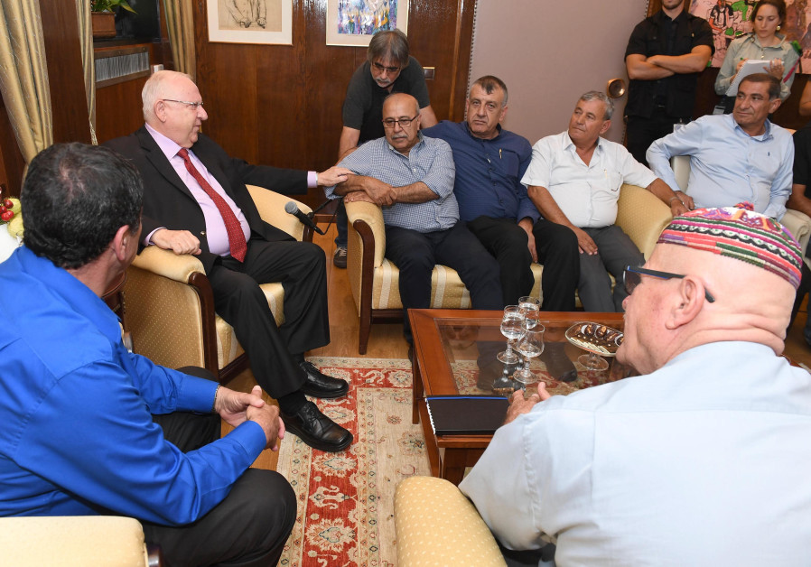 PRESIDENT REUVEN RIVLIN with Rafik Halabi (seated, at Rivlin's left) and other Druze leaders