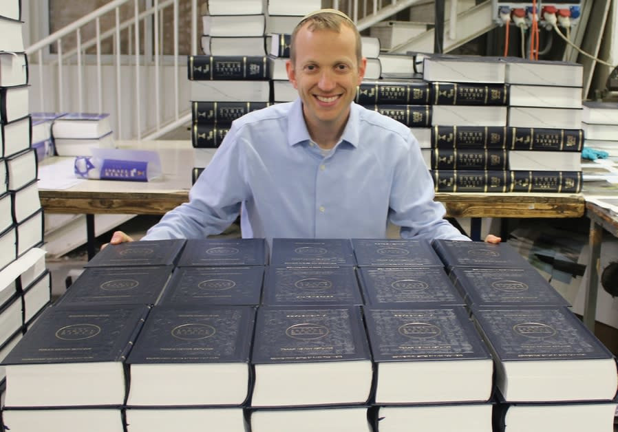 RABBI TULY Weiss poses at the first printing of The Israel Bible.