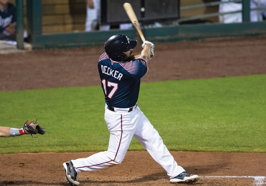 CODY DECKER takes a swing during a PCL baseball game