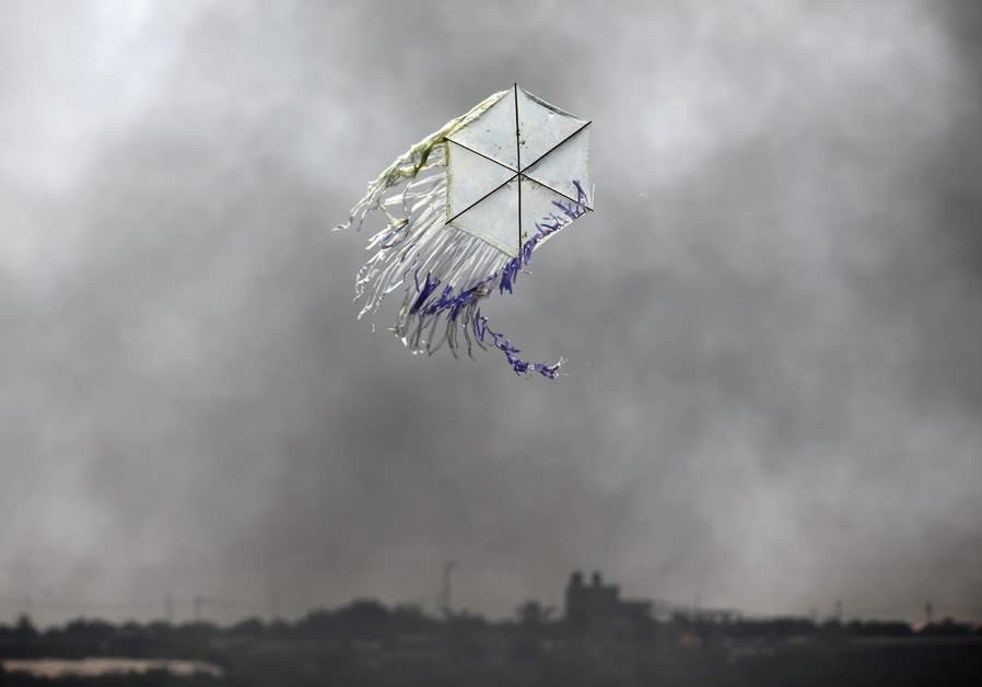 A KITE flies over the Gaza border into an area where incendiary kites and balloons have caused major
