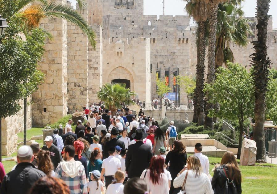 HUNDREDS OF tourists walk towards Jaffa Gate in Jerusalem