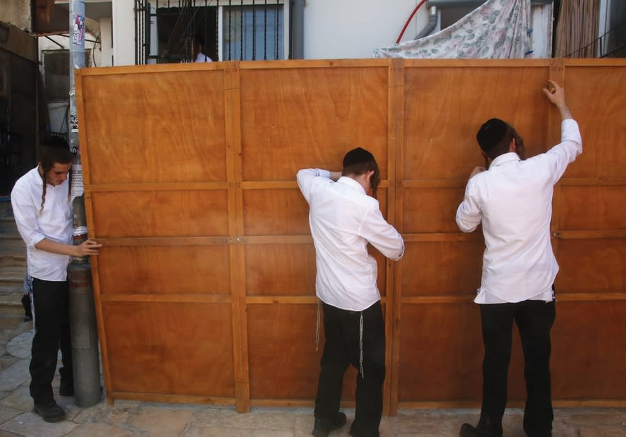 HAREDI RESIDENTS of Jerusalem's Mea She'arim neighborhood build a sukkah