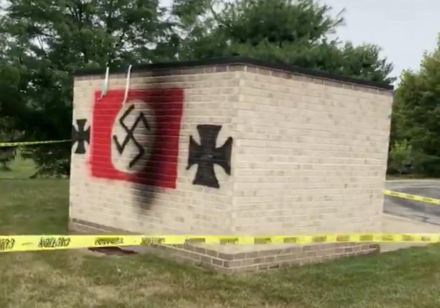 Swastika graffiti is seen painted at the Jewish Synagogue, Congregation Shaarey Tefilla