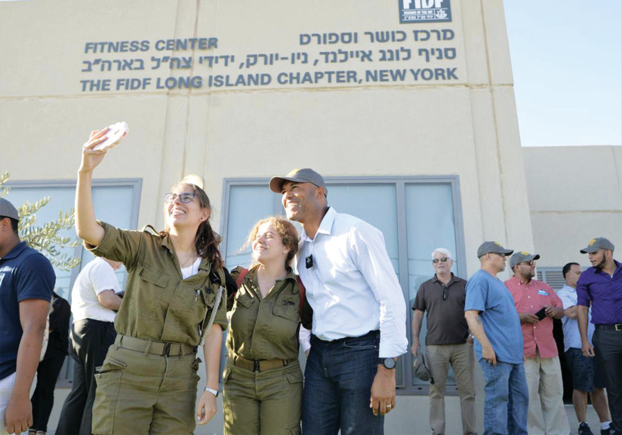 A COUPLE of Israeli soldiers take a selfie with baseball legend Mariano Rivera during his visit this