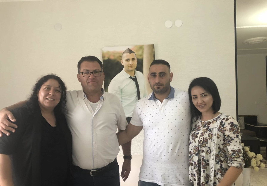 Mudi Saad and Mourad Saif with their wives, 2 August 2018.