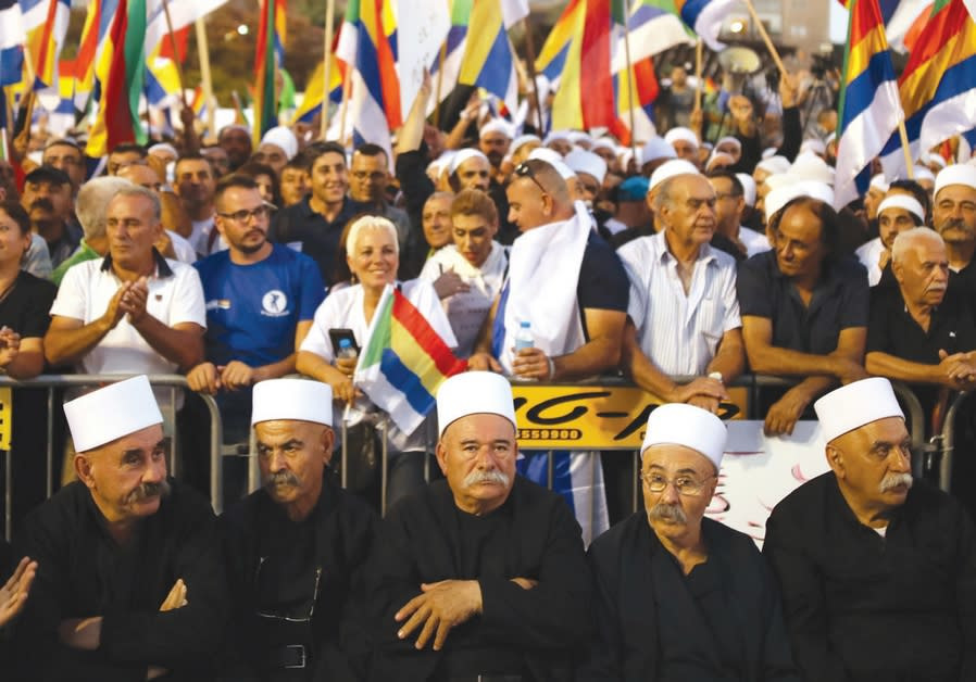 Druze leaders partake in the protest against the Nation-State Law in Tel Aviv, August 2018