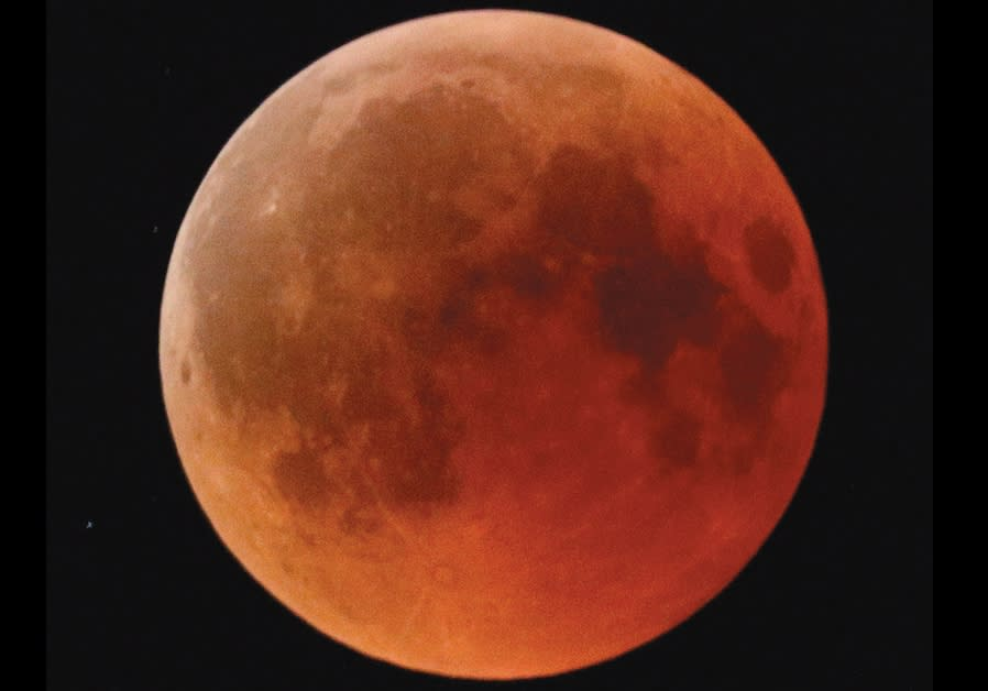 A blood moon rises, as seen from the Israeli city of Ashkelon, on July 27, 2018
