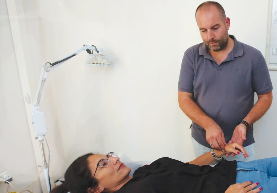Oz Levy treats a patient