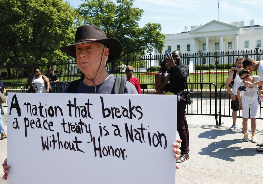 A PROTESTER makes his feelings known outside the White House as President Donald Trump announced the
